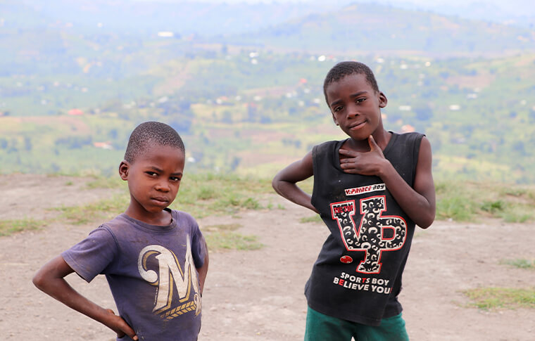 Two young boys posing for a photo