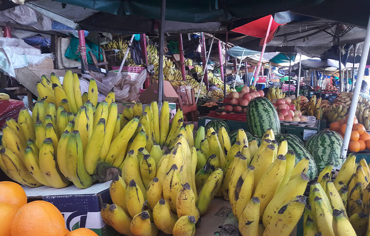 Fruit market with bright yellow bananas